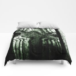 Freak in a tree Comforters