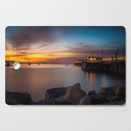 Here she comes again the sun rising at Port San Luis vila Beach Cutting Board