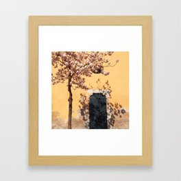 blooming tree on yellow wall background Framed Art Print
