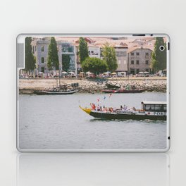 A ride on the river Laptop & iPad Skin