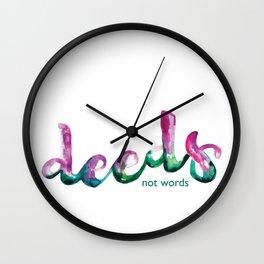 Deeds not words Wall Clock
