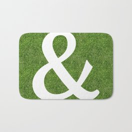 ampersand & and initial letter alphabet on the grass Bath Mat