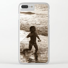 Little surfer girl runs in the waves with her bodyboard Clear iPhone Case
