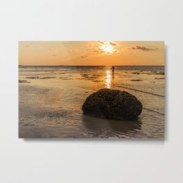 Rock and fisherman silhouette at sunset Metal Print