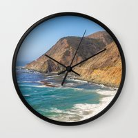 big sur Wall Clocks featuring Big Sur Blue by Jenndalyn