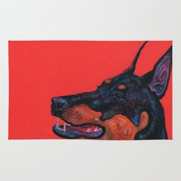 Eva the Dobermann on a Bloody red background Rug