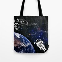 space jam Tote Bags featuring It's a Space Jam by Allison M Peret-DeRosia