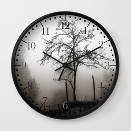 Tree in the mist Wall Clock