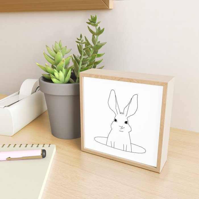 rabbit in a hole Framed Mini Art Print