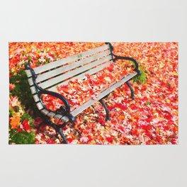 Bench in autumn park Rug