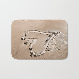 Heart in the sand Bath Mat