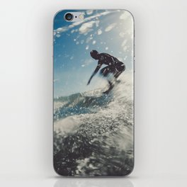 Man surfing in back light iPhone Skin