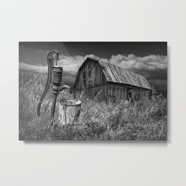 Weathered Wooden Barn with Water Pump and Metal Bucket in Black and White Metal Print