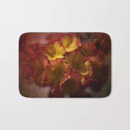 primroses on ancient texture -2- Bath Mat