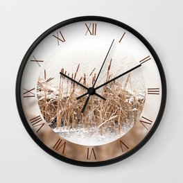 Snowed Typha reeds and frozen lake Wall Clock