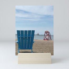 """Fairport Harbor Beach Chair"" Photography by Willowcatdesigns Mini Art Print"