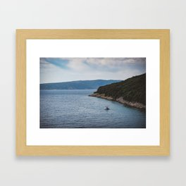 Boat leaving Valbiska bay Framed Art Print