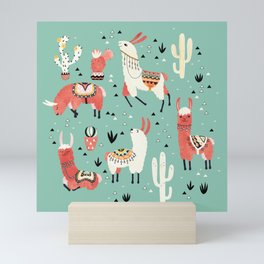Llamas and cactus in a pot on green Mini Art Print