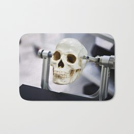 Human skull model in clamps for education Bath Mat
