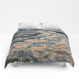 Abstract eroded rocks on beach with puddle Comforters