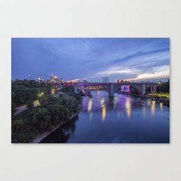 Illuminated Minneapolis and Mississippi River Birdges during a Summer Twilight Canvas Print