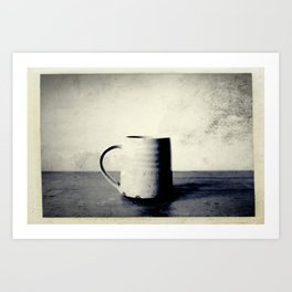 Cup of coffee on a table Art Print
