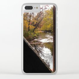 A river under a covered bridge Clear iPhone Case