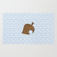 animal crossing Area & Throw Rugs featuring Animal Crossing Winter Leaf by Rebekhaart