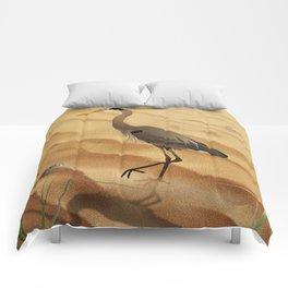 Heron on golden sands Comforters