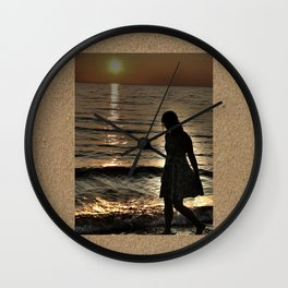 Sunset and lonely silhouette on the beach Wall Clock
