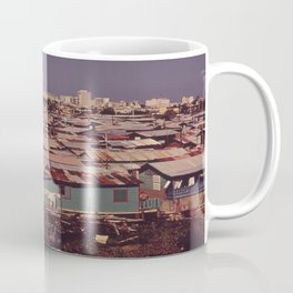 'MODERN BUILDINGS TOWER OVER THE SHANTIES CROWDED ALONG THE MARTIN PENA CANAL' Coffee Mug