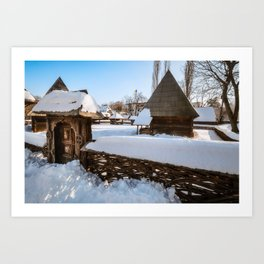 Traditional handcrafted gate and a rural Romanian homestead covered in snow Art Print
