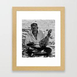 The Cretan busker Framed Art Print