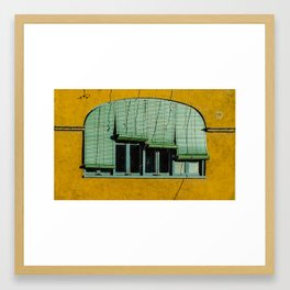 Window and rollers on yellow wall Framed Art Print