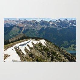 Mountain cornice with snow Rug