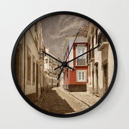 Sepia treatment of a cobbled street, Portugal Wall Clock