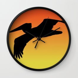 Brown Pelican in Flight Silhouette at Sunset Wall Clock
