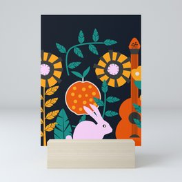 Music and a little rabbit Mini Art Print