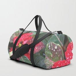 Raindrops on a poinsettia Christmas flower Duffle Bag