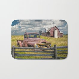 Pickup Truck behind wooden fence in a Rural Landscape Bath Mat