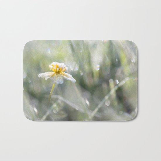 The last frost- Frozen buttercup Bath Mat