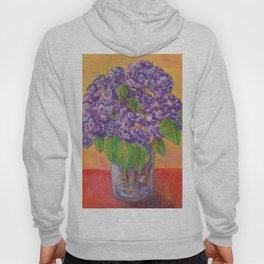 Bouquet of lilac flowers in a glass vase on an orange background Hoody