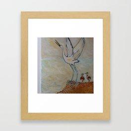 proud stork and chicks Framed Art Print