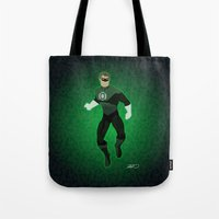 green lantern Tote Bags featuring Green Lantern by The Vector Studio