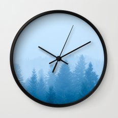 Fog over forest Wall Clock