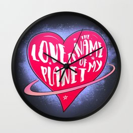 Love is the name of my planet Wall Clock