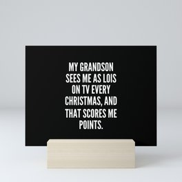 My grandson sees me as Lois on TV every Christmas and that scores me points Mini Art Print