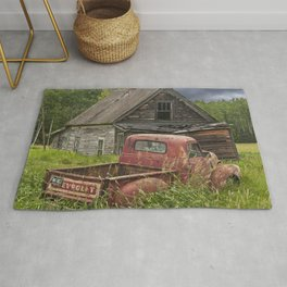 Old Chevy Pickup and Abandoned Farm House Rug