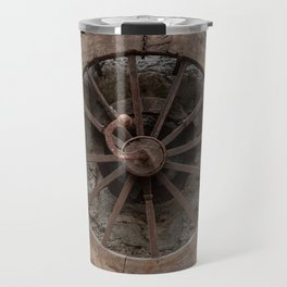 Wooden wheel hanging on a stone wall Travel Mug