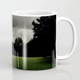 Football goalposts in an empty field Coffee Mug